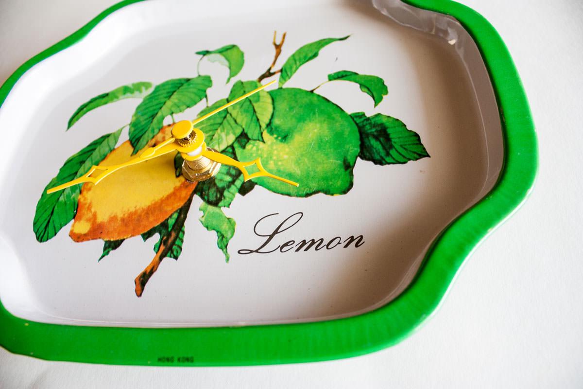 Lemon metal tray clock closeup