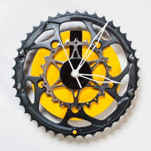 bike sprocket clock with yellow cd background