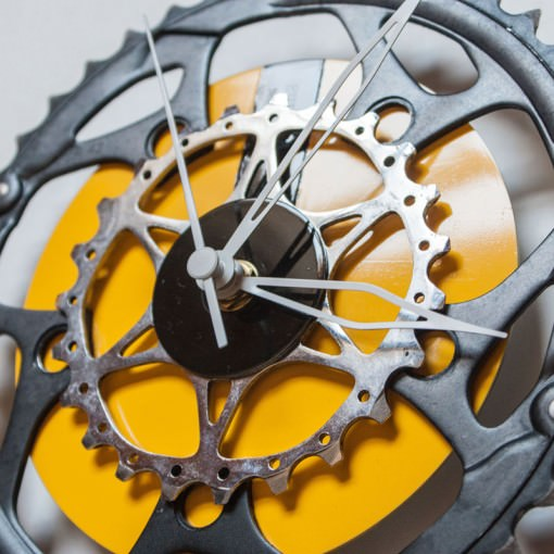 bike sprocket clock with yellow cd background right side