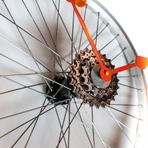 Repurposed-Bike-Wheel-Clock-Orange-and-Yellow-angle-right